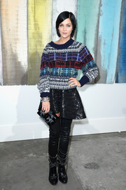 Leigh Lezark covered up with a colorful crewneck sweater for the Chanel fashion show.