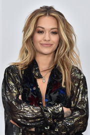 Rita Ora attended the Chanel fashion show rocking sexy teased waves.