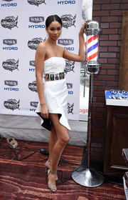 Chanel Iman showed plenty of leg in an asymmetrical white mini with a metallic waistband, also by Sally LaPointe.
