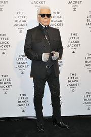 Karl Lagerfeld topped off his monochromatic look with a pair of print skinny jeans.