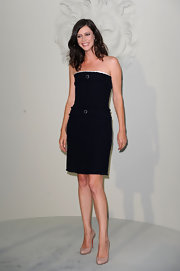 Anna achieves a simply sophisticated look in a strapless LBD and nude pumps. Coco Chanel would have been proud.