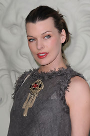 Milla paired her Chanel frock with a classic bun.