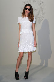 Elisa paired her black ankle boots with a white lace day dress.
