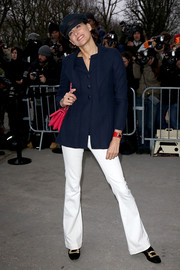 Ines de la Fressange pulled her smart-casual outfit together with a pair of flared white pants.