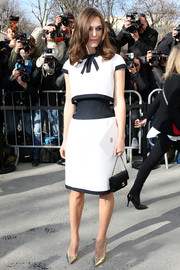 Keira Knightley styled her outfit with a classic quilted purse, also by Chanel.