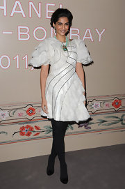 Sonam Kapoor wore a frothy cocktail dress with statement sleeves for the Chanel Pre-Fall show.