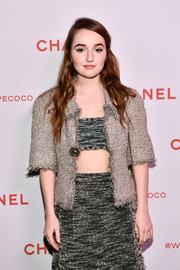 Kaitlyn Dever teamed a gold tweed jacket with a gray bandeau top and a matching pencil skirt for the Chanel Beauty House party.