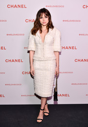 Ana de Armas was business-glam in a white tweed skirt suit by Chanel during the brand's Beauty House party.