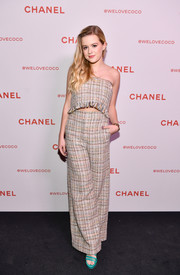 Ava Phillippe kept it youthful yet chic in a strapless tweed crop-top by Chanel during the brand's Beauty House party.
