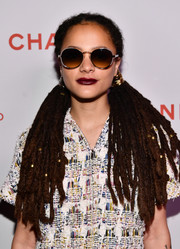 Sasha Lane wore her signature dreadlocks in a pigtail style at the Chanel Beauty House party.