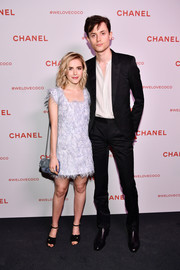 Kiernan Shipka topped off her ensemble with a blue chain-strap bag, also by Chanel.