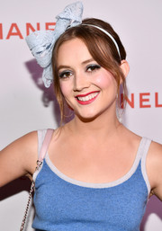 Billie Lourd went for an ultra-girly finish with a blue lace bow headband.