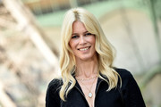 Claudia Schiffer was boho-chic with her center-parted waves at the Chanel Haute Couture show.