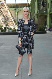 Katy Perry's astronaut-print jacket, skirt, and long shorts ensemble at the Chanel Couture show was a fun way to suit up!