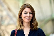 Sofia Coppola wore her hair in shoulder-length waves at the Chanel Haute Couture show.
