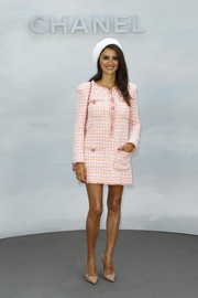 Penelope Cruz flashed her legs in a pink tweed mini dress by Chanel during the label's Couture Fall 2018 show.