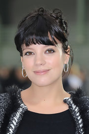 Lily Allen pulled her hair up in loose ringlets for the Chanel Spring 2011 fashion show.