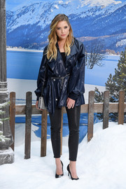 Ashley Benson paired a loose navy vinyl jacket with black leather skinnies for the Chanel Fall 2019 show.