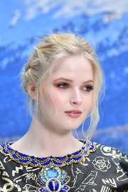 Ellie Bamber sported a messy updo at the Chanel Fall 2019 show.