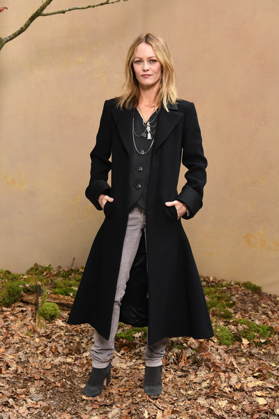 Vanessa Paradis was a rock star in a black coat with a flared hem at the Chanel Fall 2018 show.