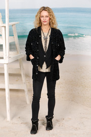 Vanessa Paradis layered a black velvet-burnout jacket over a matching vest and a nude shirt for the Chanel Spring 2019 show.