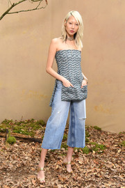 Soo Joo Park contrasted her dressy top with casual ripped capri jeans.