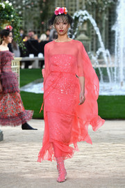 Soo Joo Park looked super sophisticated in a coral sequin dress with a fluttery sheer overlay at the Chanel Couture runway show.