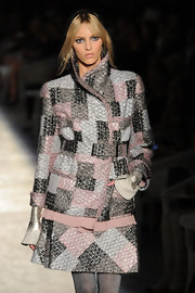 Anja Rubik looked quintessentially Chanel in this multicolored tweed skirt suit.