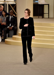 Kristen Stewart looked perfectly refined in a black velvet pantsuit by Chanel during the brand's Couture Fall 2015 show.