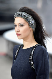 A bejeweled silver headband kept Bella Hadid's stylish coiffure in place.