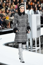 A pair of silver and black knee-high boots sealed off Kendall Jenner's winter-chic look.