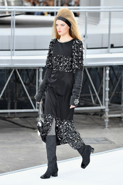 Gray knee-high boots completed Josephine Skriver's look.