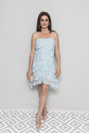 Penelope Cruz attended the Chanel and Vanity Fair party at Cannes wearing a baby-blue ruffle dress.