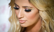 Chantelle Houghton accented her eyes with glitter shadows, feathery false lashes and even adhesive crystals at the launch of Fake It! eyelashes.