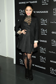 Vanessa was dressed for a winter soiree in this dark lacy ensemble at the Charity Meets Fashion Holiday Celebration.