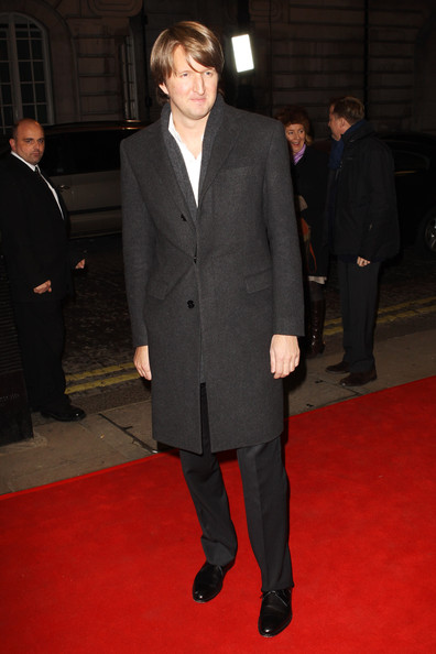 Tom Hooper hit the red carpet in a snug wool trench coat.