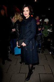 Elizabeth McGovern exuded vintage elegance at the pre-BAFTA dinner in a patterned midnight-blue coat.