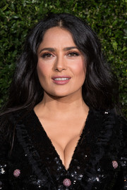 Salma Hayek wore her hair down in a subtly wavy style at the Charles Finch and Chanel pre-BAFTA dinner.