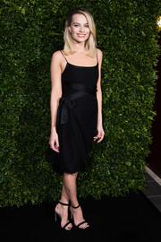 Margot Robbie polished off her look with black ankle-strap sandals by Jimmy Choo.