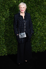 Glenn Close paired a midnight-blue tweed coat by Chanel with black wide-leg pants for the Charles Finch pre-BAFTA dinner.