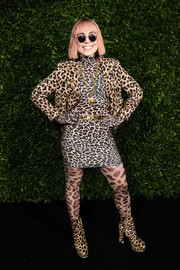 Noomi Rapace matched her dress with a leopard-print moto jacket.