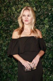Julia Stiles attended the Charles Finch & Chanel pre-BAFTA party carrying a metallic clutch with spiked sides.