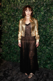 Emilia Clarke gave her sexy frock an edgy punch with a gold biker jacket.