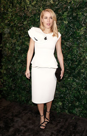 Gillian Anderson donned a white SAFiYAA peplum dress for the Charles Finch & Chanel pre-BAFTA party.
