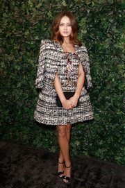 Ella Purnell kept it classy in a monochrome tweed skirt suit by Chanel Couture at the pre-BAFTA party.