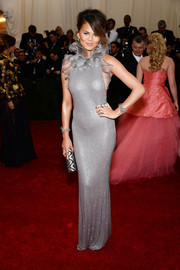 Chrissy Teigen looked like an exotic flower in a slinky silver ruffle-neckline gown by Ralph Lauren during the Met Gala.