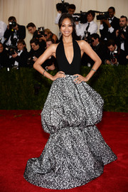 Zoe Saldana turned heads at the Met Gala in a black-and-white Michael Kors halter gown featuring a puffy paisley-print skirt.