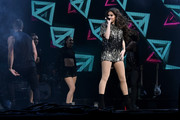 Hailee Steinfeld teamed black Louboutin boots with a paillette top for her concert at the Radio City Music Hall.