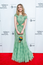 Suki Waterhouse went for playful styling with a crystal hot air balloon purse by Judith Leiber.