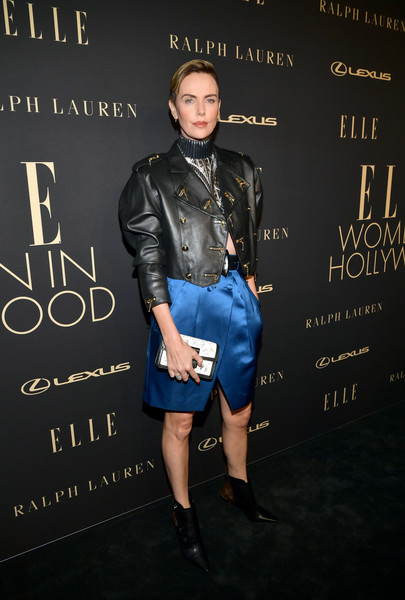 Charlize Theron Beaded Clutch [clothing,leather,fashion,textile,jacket,footwear,denim,electric blue,fashion design,leather jacket,lexus - arrivals,26th annual women in hollywood celebration,ralph lauren,charlize theron,los angeles,beverly hills,california,the four seasons hotel,elle,lexus]